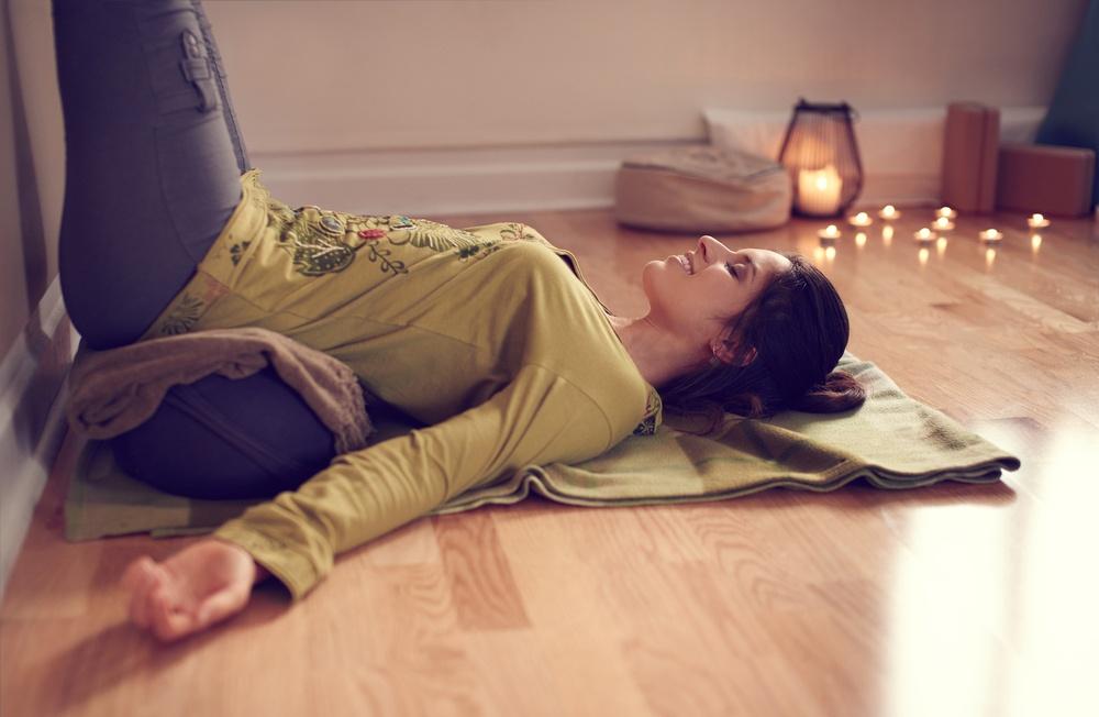 Attractive mixed race woman doing restorative yoga-1.jpeg