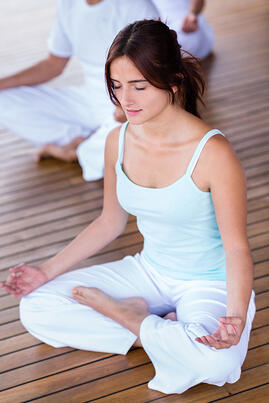 Beautiful yoga woman meditating with eyes closed
