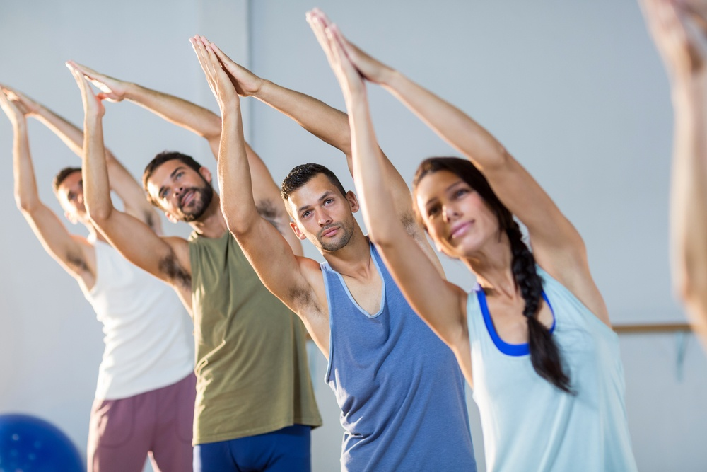 Group of people exercising in fitness studio.jpeg